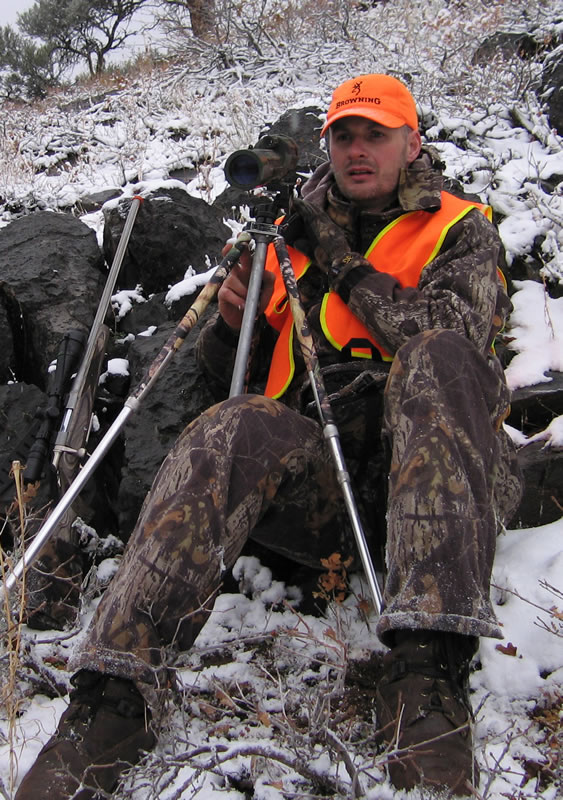 Spotting for deer with my 243 WSSM A-Bolt Stainless Varmint Laminate with fluted barrel.