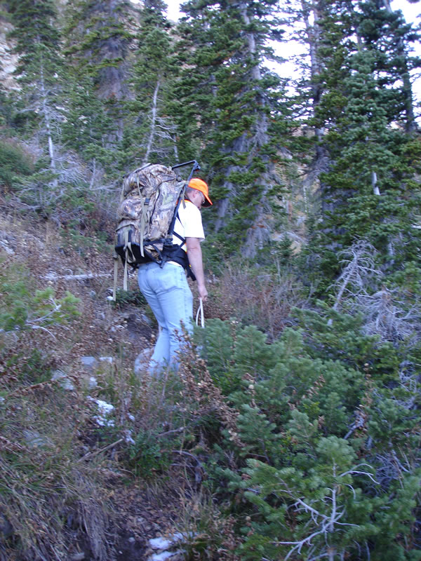 Weston hauling out elk meat with his Cabelas Alaskan frame pack