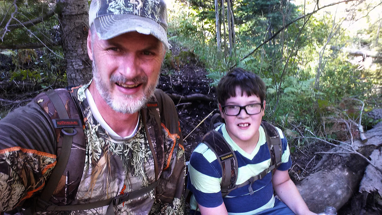 Selfie of Landen and me while checking trail cameras